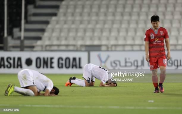 TOPSHOT Iran's Persepolis FC team players react after winning the AFC Champions League football match between Qatar's Lekhwiya club and Persepolis FC...