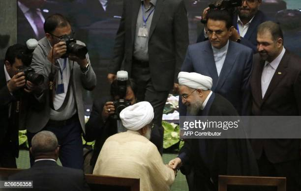 Iran's President Hassan Rouhani greets visitors after being sworn in before parliament in Tehran on August 5 2017 Rouhani warned the US against...