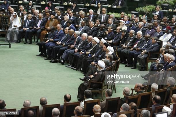 Iran's President Hassan Rouhani sits next to Judiciary Chief Sadeq Larijani Afghan President Ashraf Ghani and Iraqi President Fuad Masum during...