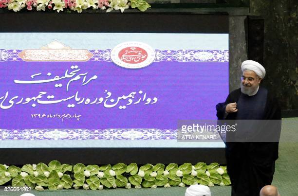 Iran's President Hassan Rouhani speaks to officals after his swearing in ceremony in Tehran on August 5 2017 Rouhani warned the US against tearing up...