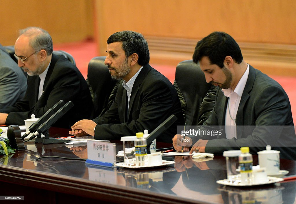 Iran's President <a gi-track='captionPersonalityLinkClicked' href=/galleries/search?phrase=Mahmoud+Ahmadinejad&family=editorial&specificpeople=221337 ng-click='$event.stopPropagation()'>Mahmoud Ahmadinejad</a> (C) attends a bilateral meeting with Chinese President Hu Jintao at the Great Hall of the People on June 8, 2012 in Beijing, China. China announced that it will provide a 150 million yuan (23.8 million US dollars) grant to the Afghan government during 2012, state media reported.