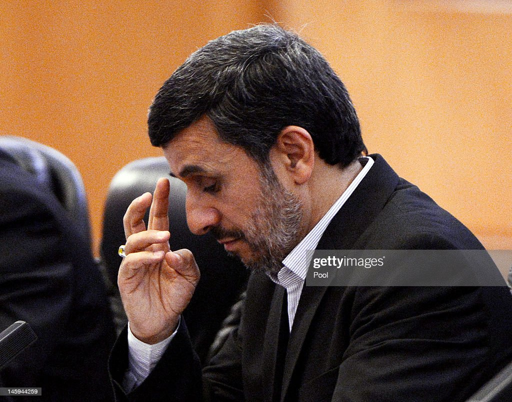 Iran's President <a gi-track='captionPersonalityLinkClicked' href=/galleries/search?phrase=Mahmoud+Ahmadinejad&family=editorial&specificpeople=221337 ng-click='$event.stopPropagation()'>Mahmoud Ahmadinejad</a> attends a bilateral meeting with Chinese President Hu Jintao at the Great Hall of the People on June 8, 2012 in Beijing, China. China announced that it will provide a 150 million yuan (23.8 million US dollars) grant to the Afghan government during 2012, state media reported.