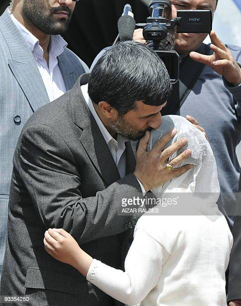 Iran's President Mahmoud Ahmadinejad is greeted by a Muslim girl November 24 2009 upon his arrival at the airport in La Paz Ahmadinejad arrived in...