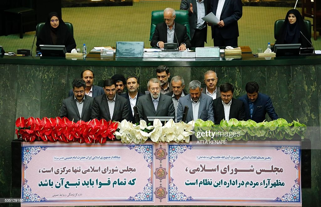 Iran's re-elected Parliament speaker Ali Larijani (C) speaks, as he is surrounded by MPs, following the announcment of the result in Tehran on May 29, 2016. Larijani, a moderate conservative, retained the speakership of Iran's parliament despite major gains for reformists in February elections, benefiting from credit gained by his support for last year's nuclear deal. / AFP / ATTA