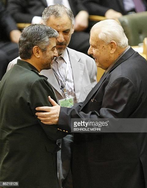 Iran's Revolutionary Guards commander Mohammad Ali Jafari shakes hands with Palestinian ambassador to Iran Salah alZavavi during a conference in...