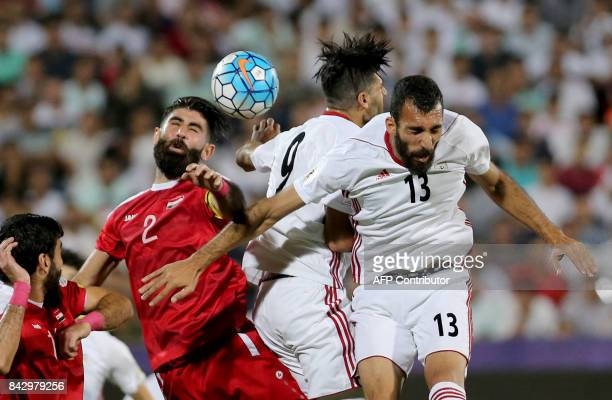 TOPSHOT Iran's Rouzbeh Chashmi vies for the ball against Syria's Moualad alAjjan during the FIFA World Cup 2018 qualification football match between...