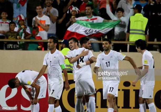 Iran's Sardar Azmoun celebrates scoring a goal against Uzbekistan`s team during the 2018 World Cup qualifying football match between Iran and...