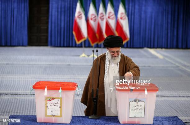 Iran's Supreme Leader Ayatollah Ali Khamanei casts his ballot during Iran's 12th presidential election in Tehran Iran on May 19 2017