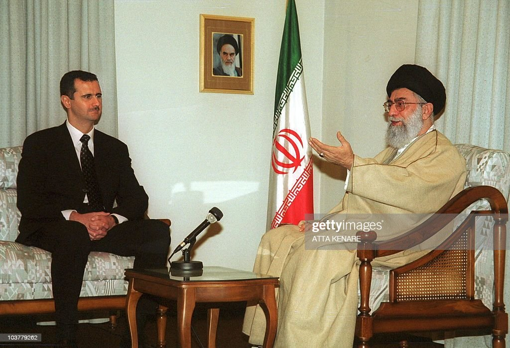 Iran's supreme leader Ayatollah Ali Khamenei (R) meets Syrian President <a gi-track='captionPersonalityLinkClicked' href=/galleries/search?phrase=Bashar+al-Assad&family=editorial&specificpeople=206274 ng-click='$event.stopPropagation()'>Bashar al-Assad</a> in Tehran 25 January 2001. Assad, on his first visit to the Islamic Republic since taking power six months ago, described the policies of the former US administration on the Middle East peace process as a failure. AFP PHOTO/Atta KENARE