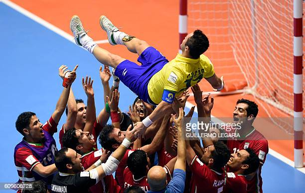 Iran's team players throw in the air Brazilian player Falcao as they celebrate their victory over Brazil in their Colombia 2016 FIFA Futsal World Cup...