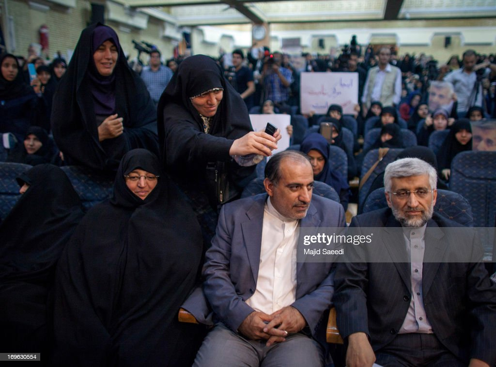 Iran's top nuclear negotiator and presidential candidate for the upcoming elections, <a gi-track='captionPersonalityLinkClicked' href=/galleries/search?phrase=Saeed+Jalili&family=editorial&specificpeople=4586103 ng-click='$event.stopPropagation()'>Saeed Jalili</a> (R), attends a campaign rally, attended by his female supporters on May 29, 2013 in Tehran, Iran. Jalili, who is running in next month's presidential elections says he will promote a policy of resistance against the West if elected. The elections are scheduled for June 14 and Jalili has stated that he wishes to revive policies of the 1979 Islamic revolution that brought clerics to power.