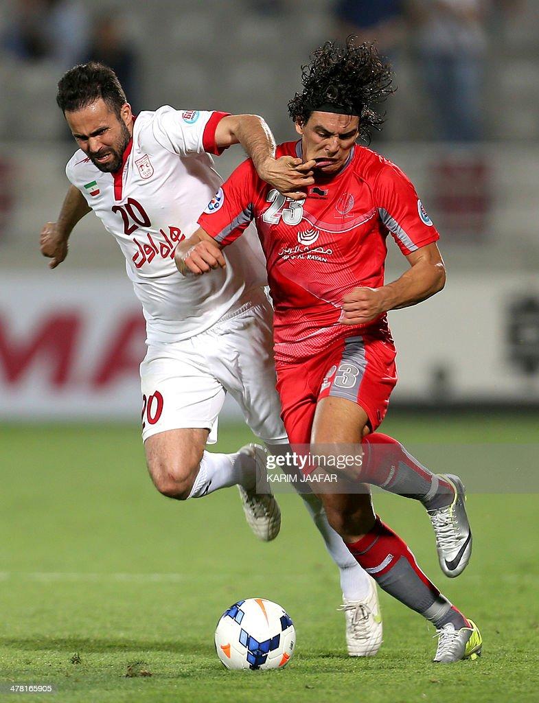 Iran's Tractorsazi Tabriz defender Mohammad Nosrati challenges Qatar's Lekhwiya forward Sebastian Soria during their AFC Champions League group C...