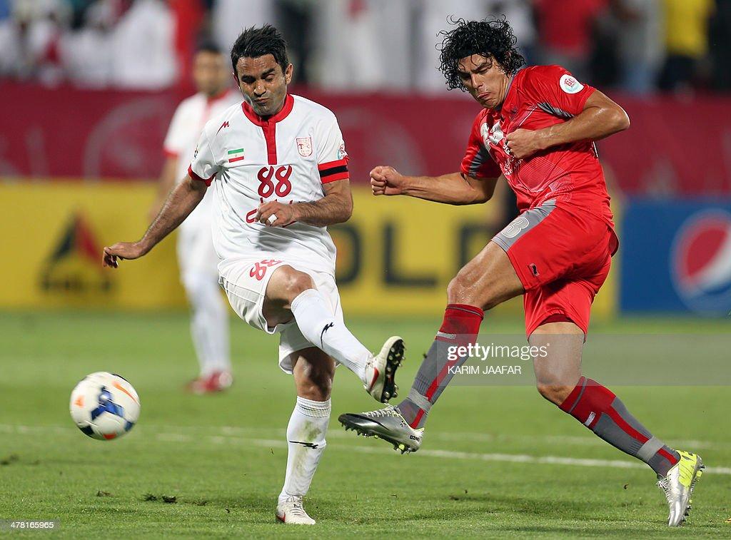 Iran's Tractorsazi Tabriz defender Morteza Asadi challenges Qatar's Lekhwiya forward Sebastian Soria during their AFC Champions League group C...