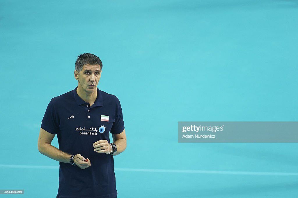 Iran's trainer coach Slobodan Kovac looks to the ball during the FIVB World Championships match between USA and Iran at Cracow Arena on September 2, 2014 in Cracow, Poland.