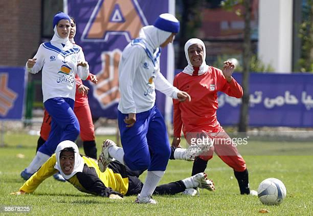 Iran's women national football team play a friendly football match with club Malavan Anzali football team in Tehran on June 25 2009 The head of...
