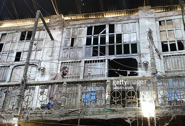 A man walks along a veranda above ground level shops that leads to disused offices in the 400yearold souk alKazemiya in central Baghdad 20 August...