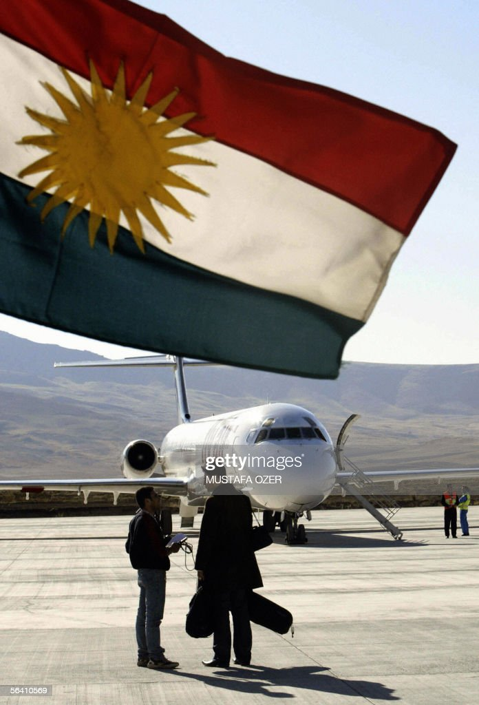 A plane seen behind a Kurdistan flag just upon its arrival 10 December 2005 in Suleimaniya airport northern Iraq A private budget airline Fly air has...