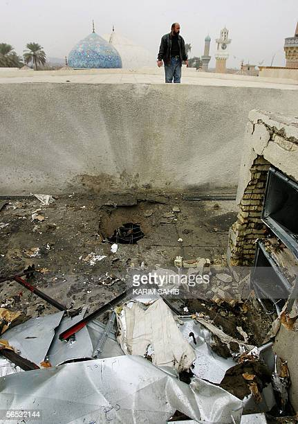 A security officer look at the damage caused to a section of the roof of a main Sunni Arab shrine the Abdul Kader alGilani shrine in central Baghdad...