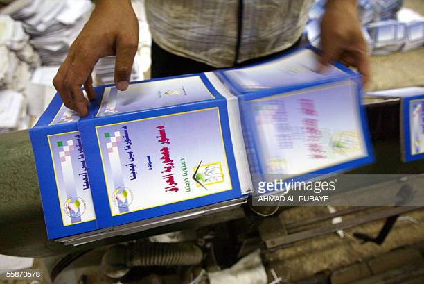 An Iraqi worker prepares copies of the draft constitution at a local printing house in Baghdad 07 October 2005 ahead of its distribution across the...