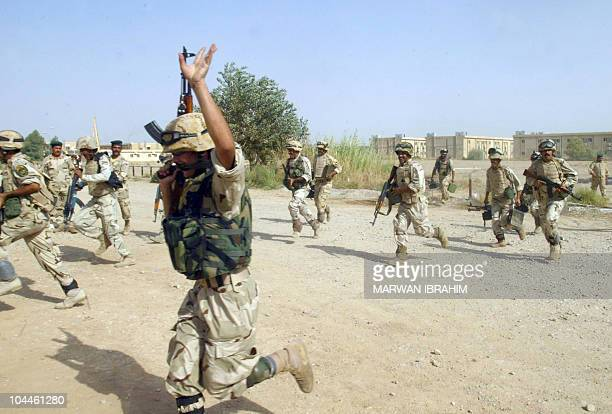 Iraq army soldiers and commandos show off their antiterrorism skills and skills against criminal activities at a camp in the northern Iraqi city of...