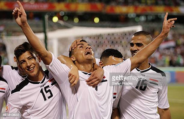 Iraq celebrate after Ahmed Yaseen Gheni of Iraq scored a goal during the 2015 Asian Cup match between Iraq and Palestine at Canberra Stadium on...