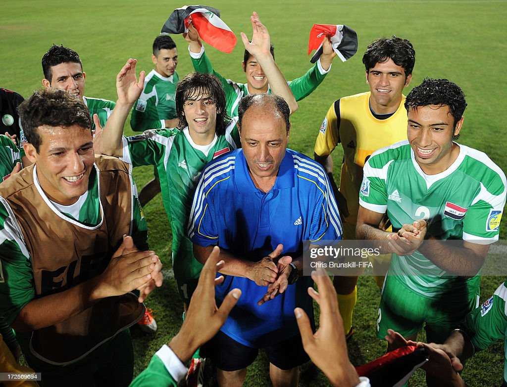 Iraq coach Hakeem Al Azzawi (C) celebrates with his players following the FIFA U20 World Cup Round of 16 match between Iraq and Paraguay at Akdeniz University Stadium on July 03, 2013 in Antalya, Turkey.