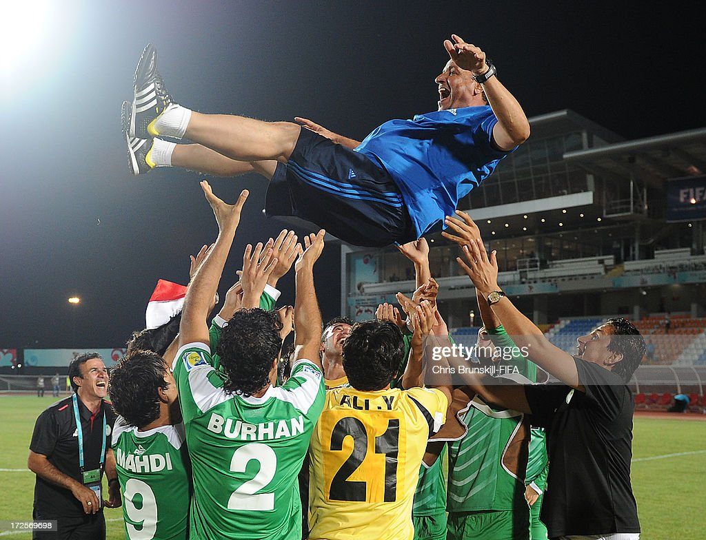 Iraq coach Hakeem Al Azzawi is thrown in the air by his players following the FIFA U20 World Cup Round of 16 match between Iraq and Paraguay at Akdeniz University Stadium on July 03, 2013 in Antalya, Turkey.