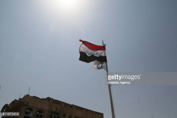Iraq flag is seen after Mosul completely freed from Daesh in Mosul Syria on July 9 2017 Mosul was captured by Daesh along vast swathes of territory...