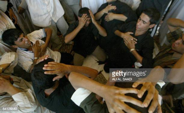 Iraqi mourners beat their chests in a Shiite grieving ritual during a symbolic funeral held for the victims killed during the Baghdad bridge stampede...