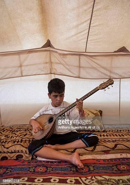 Iraq Kurdistan Erbil dylan a blind syrian refugee playing saz