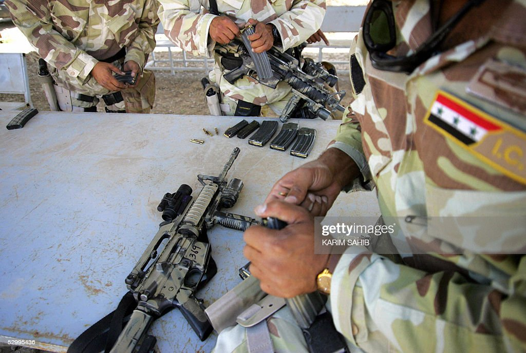 Members of Iraqi counterterrorism force the elite of the Iraqi army train on US M4 rifles at a training camp west Baghdad 29 May 2005 Tens of...