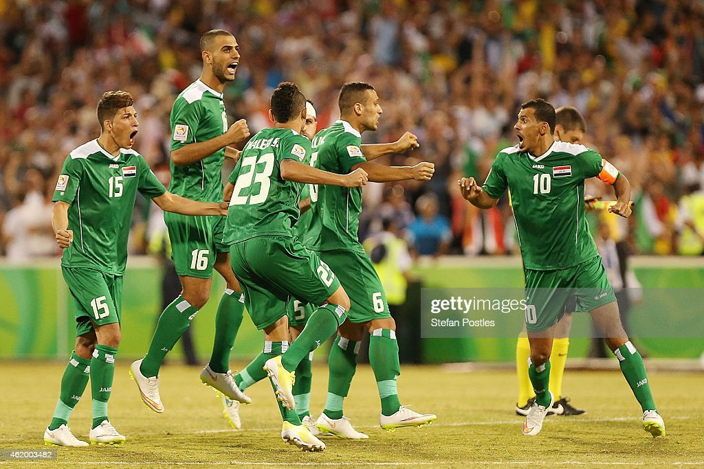 Iraq players celebrate during penalties during the 2015 Asian Cup match between Iran and Iraq at Canberra Stadium on January 23 2015 in Canberra...