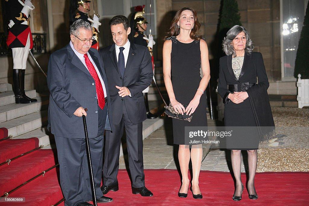 LR Iraq president Jalil Talabani French president Nicolas Sarkozy Carla BruniSarkozy and Hero Talabani attend the dinner honoring Iraq President...