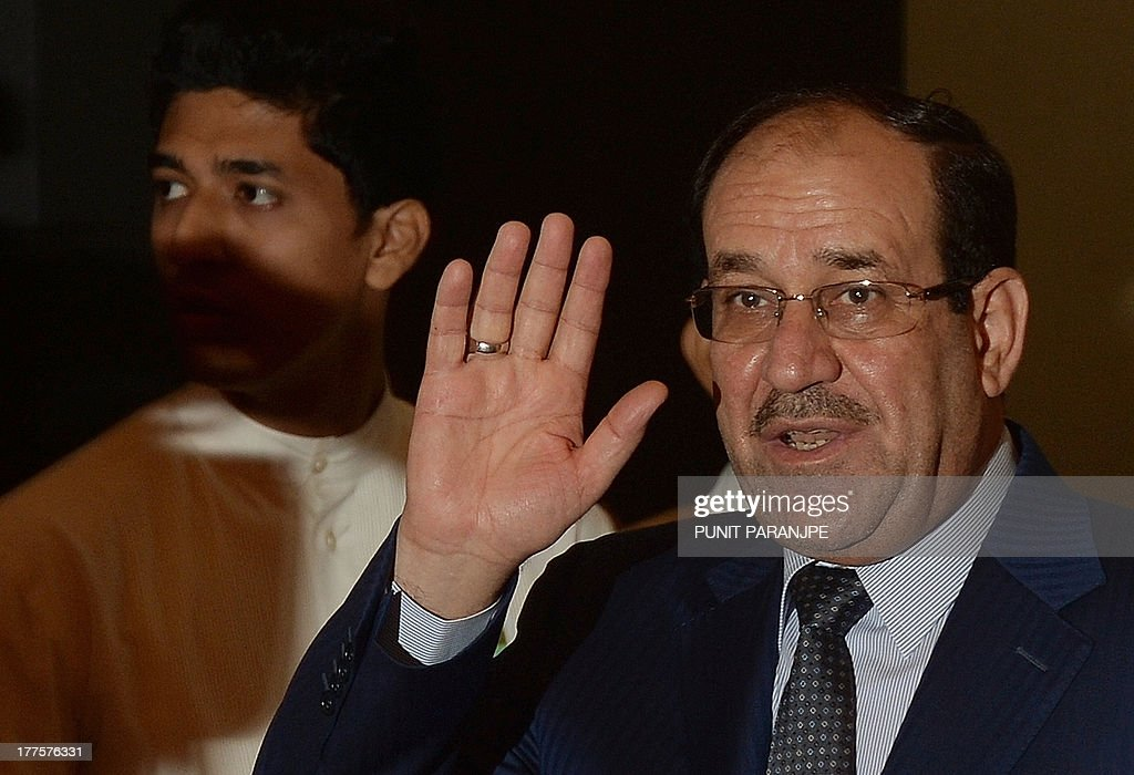 Iraq Prime Minister Nuri Al-Malaki gestures as he arrives to address Indian business delegates at a meeting in Mumbai on August 24, 2013. Iraq's prime minister pitched for investment from India to rebuild his war-shattered nation, which is a critical energy supplier to New Delhi, during his state visit to the country.