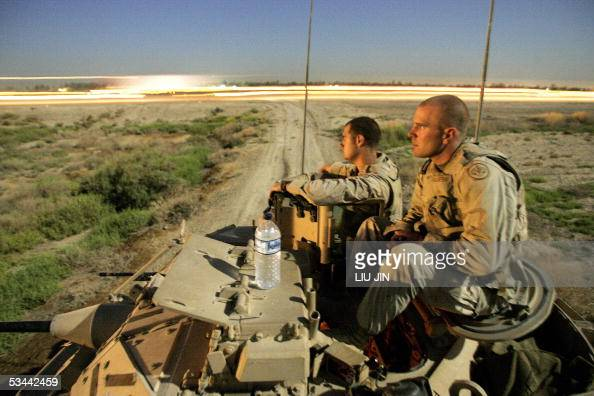 Private David Stanislowski from Pocatell Idaho of the Lighting Troops 3rd Squadron 3rd Armored Cavalry Regiment and his fellow soldier First...