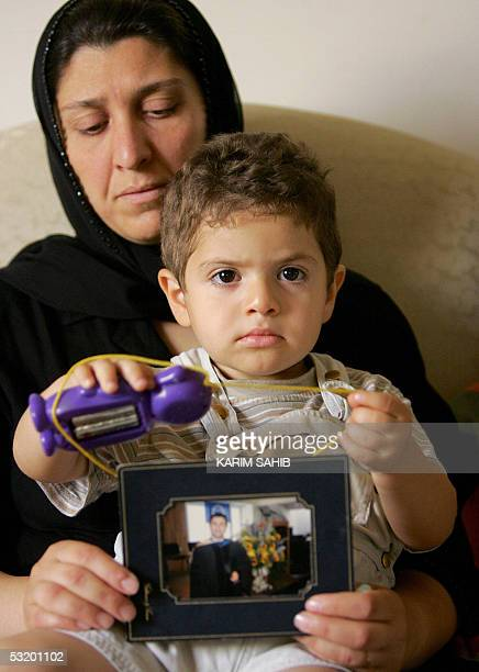 TO GO WITH AFP FRENCH AND ARABIC STORY IRAQUSSWITZERLANDKURDS Iraqiborn Swiss national Taban widow of Salah Jmor hold the picture of her husband as...