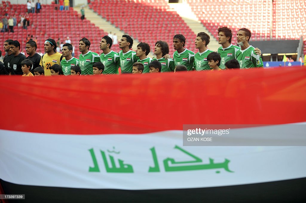 Iraq Under 20 national team sing the national anthem on July 13, 2013 before playing Ghana during a FIFA Under 20 World Cup third-place football match at the Turk Telecom Arena in Istanbul.