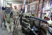 US soldiers search a suspected chemical weapons factory in the city of Mosul 370kms north of Baghdad 15 August 2005 Two different locations were...