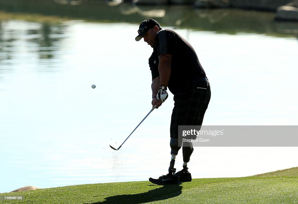 Iraq war veteran and double amputee Saul Martinez chips onto the 13th green as he plays in the pro-am during the second round of the Humana Challenge In Partnership With The Clinton Foundation at the Palmer Private Course at PGA West on January 18, 2013 in La Quinta, California.