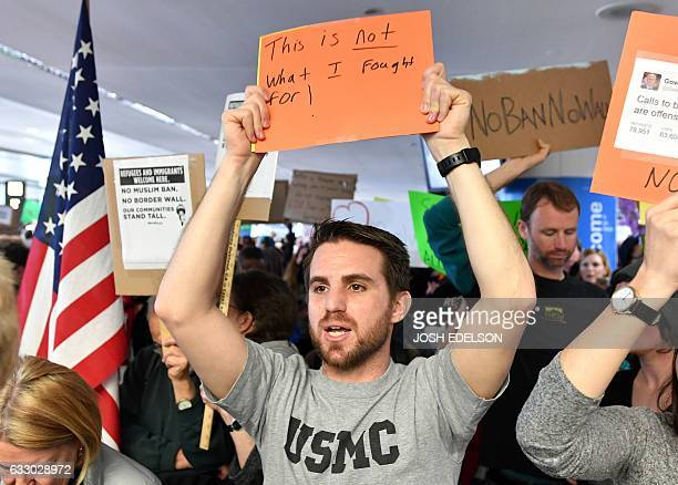 Iraq war veteran Evan Cohen holds up a sign during a protest at San Francisco International Airport in San Francisco California on January 29 2017 US...