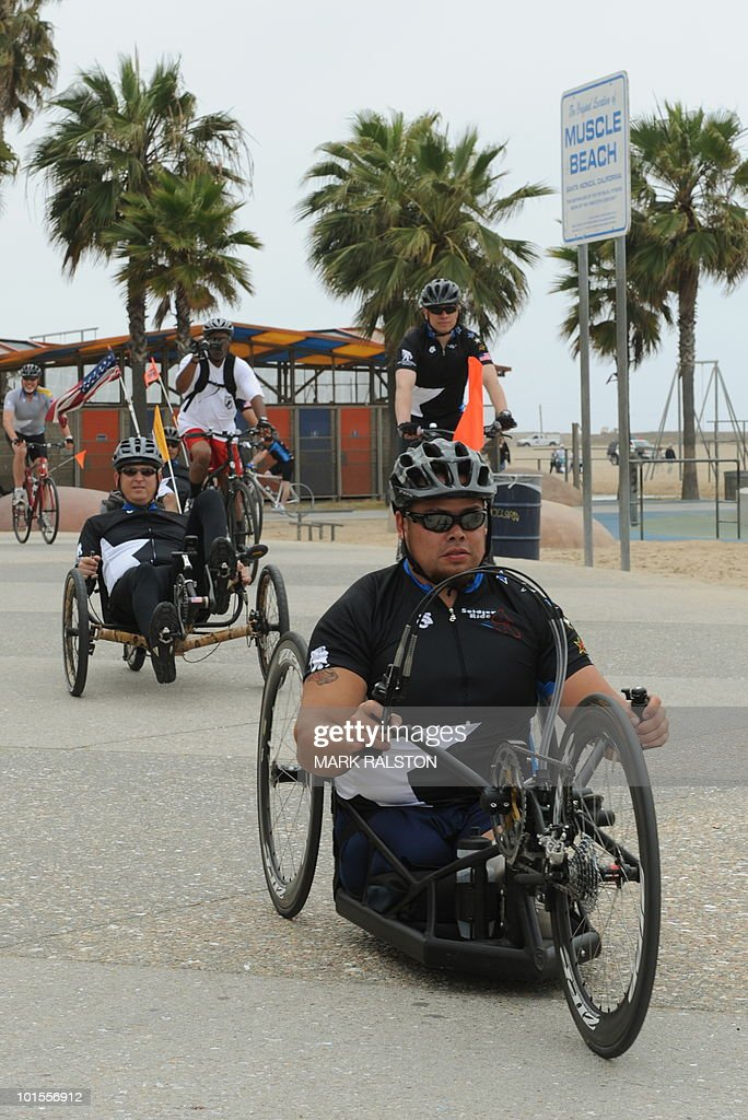 Iraq war veteran Latseen Benson (R) joins other injured war veterans as they prepare to kick off their 3 day 'Wounded Warrior Project Soldier Ride' to San Diego at Santa Monica Pier in Los Angeles on May 19, 2010. The ride will bring together thirty wounded warriors from current wars in Iraq and Afghanistan to ride on adaptive equipment from Los Angeles to San Diego. AFP PHOTO/Mark RALSTON