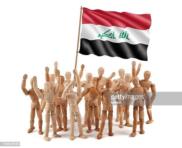 L'Irak en bois mannequin groupe avec drapeau