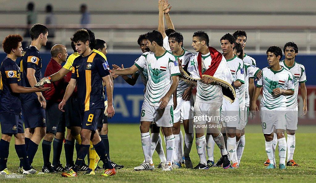 Iraqi (R) and Australian players shake hands after Iraq won the AFC U-19 Championship semi-final football match at the Emirates Stadium in Ras al-Khaimah on November 14, 2012. Iraq won 2-0 to reach the final.