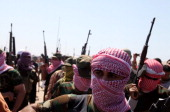 Iraqi antigovernment gunmen from Sunni tribes in the western Anbar province march during a protest in Ramadi west of Baghdad on April 26 2013 The...