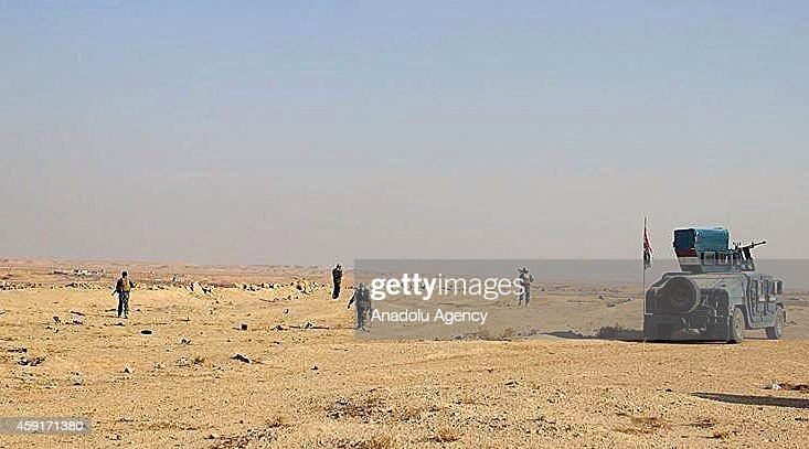 Iraqi army forces are seen in an area after regaining the whole control of Awsat town places between Al Anbar and Babel cities from Islamic State of...