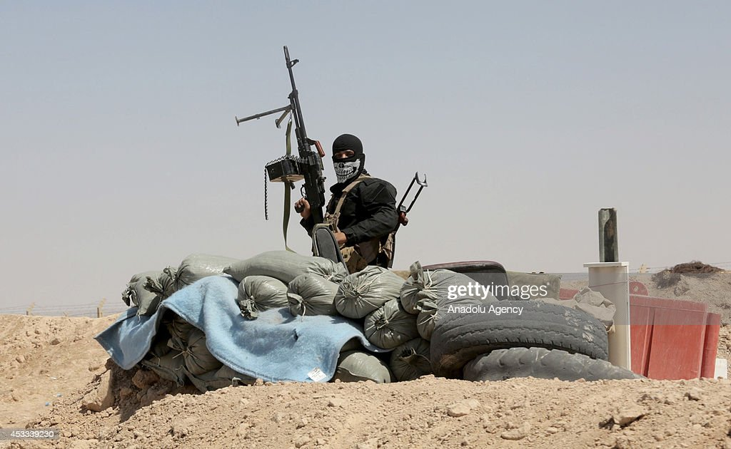 Iraqi army forces stand guard at Saladin front against Islamic State-led militants' possible attacks on August 8, 2014 in Iraq. It's stated that fierce clashes happen between Iraqi army forces and Islamic State-led militants in the city.