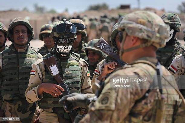 Iraqi Army recruits listen to a US Army trainer at a military base on April 12 2015 in Taji Iraq US forces currently operating in 5 large bases...