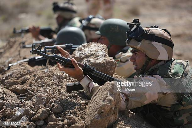 Iraqi Army recruits take part in a live fire training at a military base on April 12 2015 in Taji Iraq Members of the US Army's 573 CAV 3BCT 82nd...