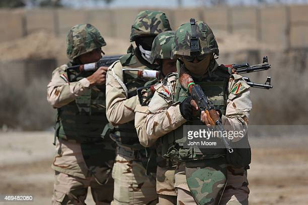 Iraqi Army recruits train under US supervision at a military base on April 12 2015 in Taji Iraq Members of the US Army's 573 CAV 3BCT 82nd Airborne...