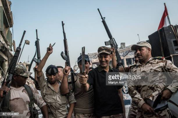 Iraqi Army soldiers celebrate the liberation of Mosul from Islamic State militants with music dancing and gunfire in the destroyed Old City district...